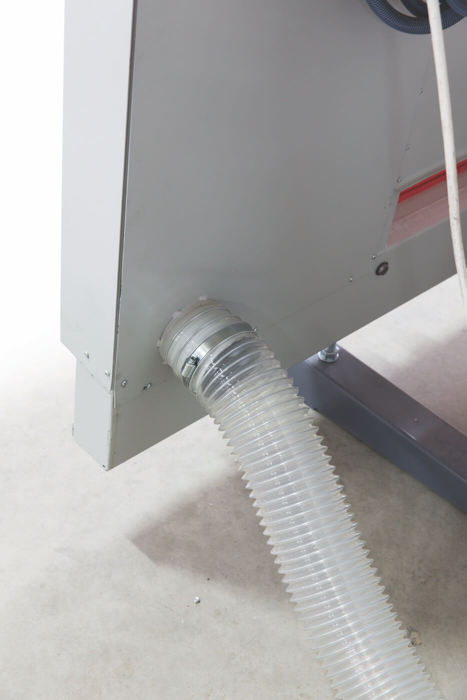TRK Suction Device, composed by hood on the right side of the machine for the whole height, with back suction mouth diam.120 mm, and one paneling among the horizontal lists in order to optimize the suction system of the machine
